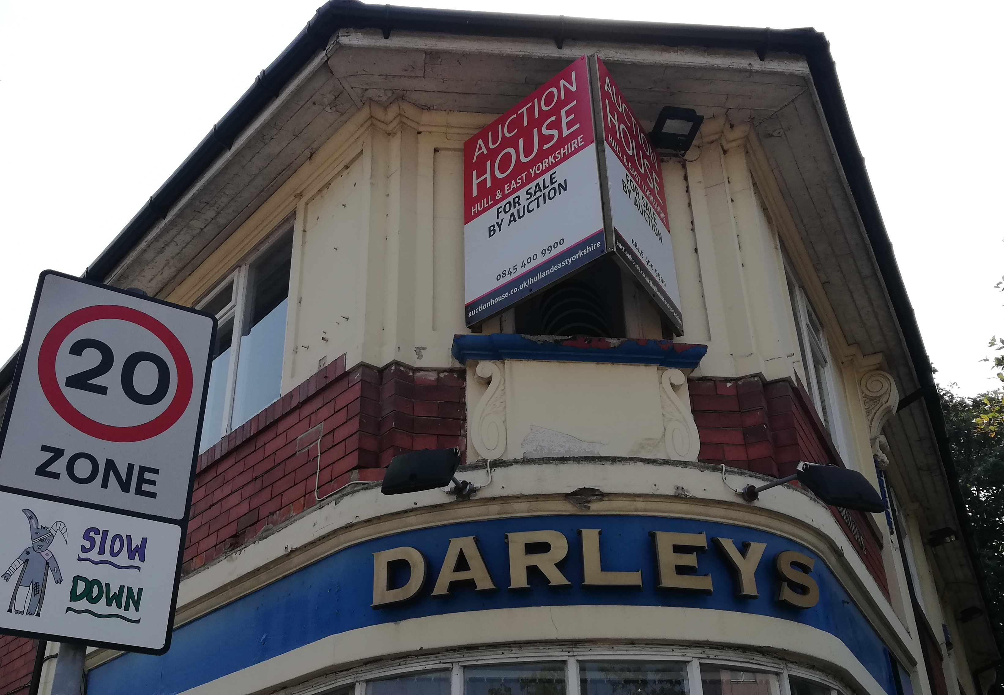 The Darley's pub with an auction house sign on the outside