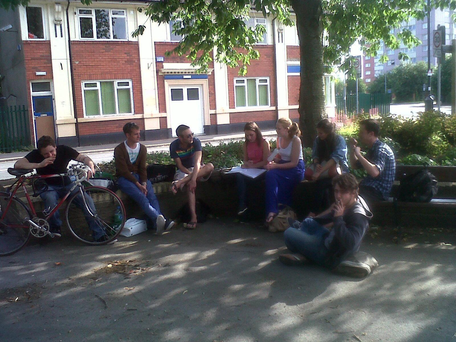 Middle Child company members sit outside Darley's in 2011